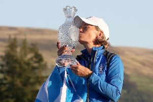 Catriona Matthew with the Saltire and a kiss for the Solheim Cup