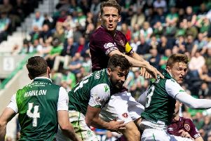 Paul Heckingbottom will have to pick a team to take on Hearts' expected combative approach. Pic: SNS