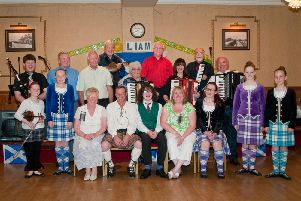 Liam, front centre, with family, friends and guests at the Scottish night.