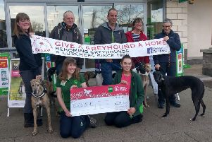 Volunteers and dogs from GAGAH receive the donation from Pets at Home staff Kayleigh Bruce and Skye Oliver