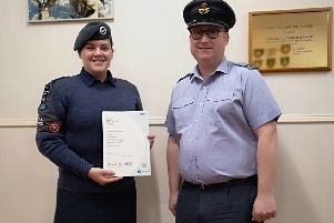 Flying Officer Martin Lee (Right) awarding BTEC Certificate to Cadet Sergeant Ailsa Westmacott