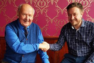 Jack Nixon is pictured with Tolbooth owner Martin Smith.