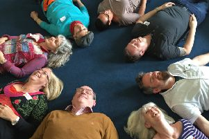 Laughter yoga employs games and songs to help get people laughing like they did when they were children