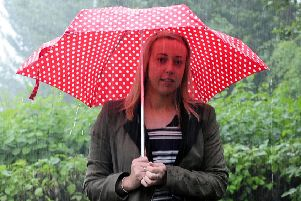 Lisa Fairley endures a wet start to Wednesday after a beautiful Tuesday