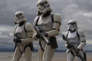 It's hard to believe these menacing Stormtroopers marching along the sand are just toys on a Scottish beach