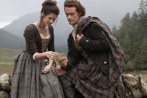The two main stars from Outlander ' Caitriona Balfe as Claire Randall and Sam Heughan as Jamie Fraser.