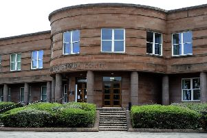 Langlees woman threw unopened vodka bottle at ambulance in Falkirk street