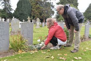 Elizabeth Preni and Colin Jenner place a floral tribute to their great uncle William Crichton. Picture: Damien Maddock