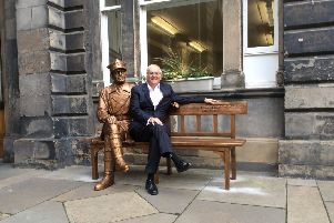 Archie Mackay pictured at the memorial bench dedicated to General Stanislaw Maczek
