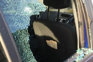 Terrance Maughan smashed a window and a windscreen of two cars