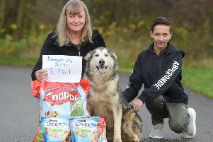 AJ Anderson makes his donation to Anne Vines and a four-legged friend at Bandeath Dog Shelter
