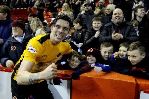 Mark McGuigan celebrates with young Stenny fans post-match (Pics: Michael Gillen)