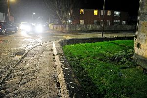 Watch Stenhousemuir residents in shock as car smashes over wall and ends up in someone's garden