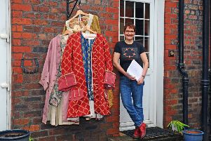 Helen Bang with some of the colourful costumes which will be worn on stage.