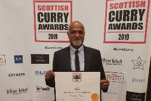 Ram Salhotra, owner of Masala Ram's, collects the Best Dining Experience of the Year title