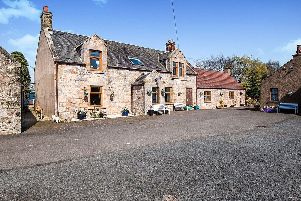 Forth Valley property: A traditional farmhouse with its own pond