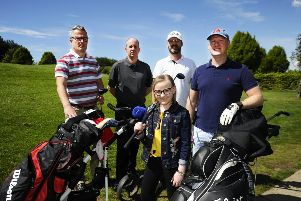 Ashlee Easton with dad Donald, far right, and golfers