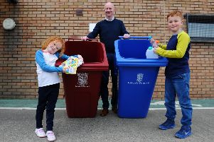 Councillor Paul Garner with Lois Friel and Leo Friel and the new bins.