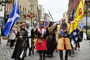 Trinity Church flags up 1298 Battle of Falkirk Day