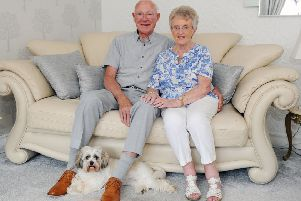 Diamond Wedding couple Archie and Ethel Blair with dog Daisy. Picture: Michael Gillen
