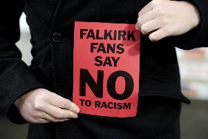 Falkirk fans funded their own red card display to respond to claims of racism at a game in November. Picture Michael Gillen.