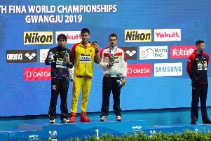 GWANGJU, SOUTH KOREA - JULY 23:  (L-R) Silver medalist Katsuhiro Matsumoto of Japan, gold medalist Sun Yang of China and bronze medalists Martin Malyutin of Russia and Duncan Scott of Great Britain pose during the medal ceremony for the Men's 200m Freestyle Final on day three of the Gwangju 2019 FINA World Championships at Nambu International Aquatics Centre on July 23, 2019 in Gwangju, South Korea. (Photo by Catherine Ivill/Getty Images)