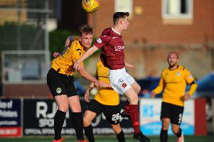 Stenhousemuir in action as Ryan Watters challenges for the ball