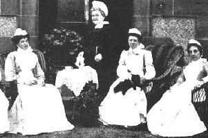 Matron Miss Joss pictured with her staff.