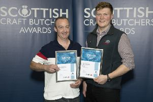 Jason Ward from John Scott Meats presents certificates to George Kirk and Sons' of Denny.