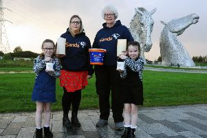 Kellie Cunningham (middle left) with nieces Zara and Elise Anderson and Sands events coordinator Marion Currie. Picture: Michael Gillen