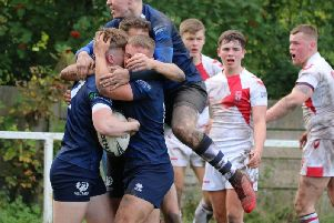 Sean Taylor mobbed by his Scotland team-mates after scoring to put Scots ahead