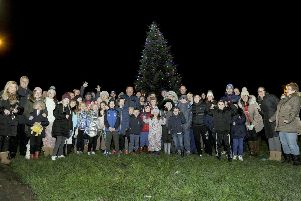 Villagers gather at the Christmas tree on Haypark Road for the switch-on ceremony. Picture: Michael Gillen