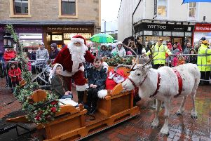 Santa and reindeer visit a very damp Falkirk