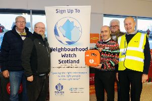 Pictured: Raymond Murray, business owner Card Rack; Jim Muir, Denny and District Community Council; Jock McLaughan, Co-op store manager; Brian McCabe, Denny and District Community Council; and Bill Gray, Denny Neighbourhood Watch and Denny and District Community Council. Picture: Michael Gillen