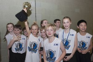 Captain Jay Bunyan lifts the Scottish Junior NBA trophy for St Margaret's. Picture Roberto Cavieres.