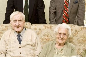ANNIVERSARY: Isabella and Charles Imrie of University Avenue Pittenweem celebrate 70 yrs of marriage on October 11. Couple are shown with cllr Mike Scott-Hayward (who presented flowers on behalf of Fife Council) and Deputy Lord Lieutenant John Macinness.