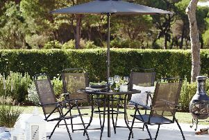 Oslo four-seater dining set and parasol, available from Dunelm. Photo: PA Photo/Handout.