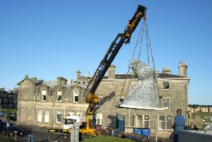 Kelpie Maquettes being lowered into position in St Andrews. (Peter Adamson)