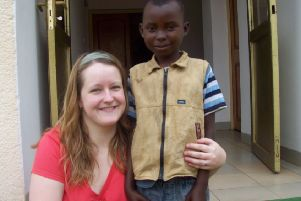 Suzie with one of the youngsters she has been helping in Rwanda.