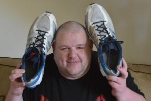 David Henderson with his size 19 trainers.