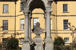The bust of John Hunter at the former entrance to the hospital which bore his name