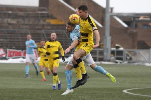 David McKay wins this duel for Raith Rovers (picture by Chris Coutts)