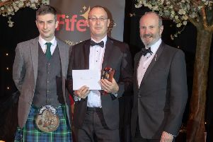 Excellence in Community Engagement category sponsored by Rennies Coaches, presented by David Frenz, Operations Director at Stagecoach East Scotland and host Fred MacAulay to MKM Building Supplies. Pic: Kenny Smith.