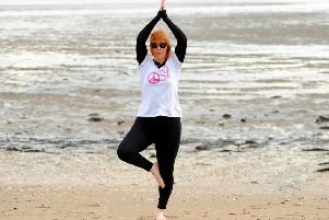 Cara practises yoga on Burntisland beach. Pics by FPA