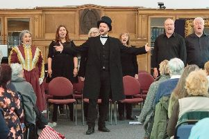 Andrew Carnegie's great-great-great grandson Joe Whiteman (centre) and Ian Hammond Brown (second right), writer of Carnegie the Star Spangled Scotchman, join some of the cast in performing songs from the show at the launch at the Dunfermline Carnegie Library & Galleries. Pic: ASM Media & PR.