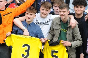 Raith fans with shirts given to them by players after Saturday's match at Queens (Pic: Fife Photo Agency)
