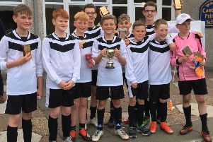 The winning Anstruther team with their trophy.