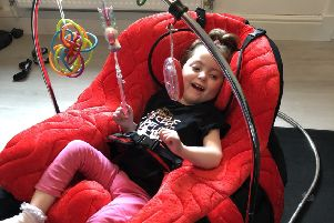 Emelia in her new chair.