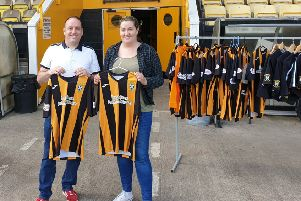 Chelsea and Ross from Fife SAMH Service choose  East Fife FC strips ahead of the event.