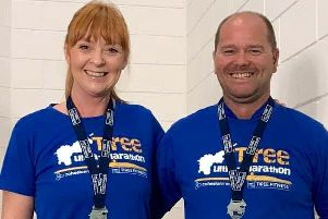 Davie Hogg and Karen Richards with their Tiree 35 Mile Ultra medals.